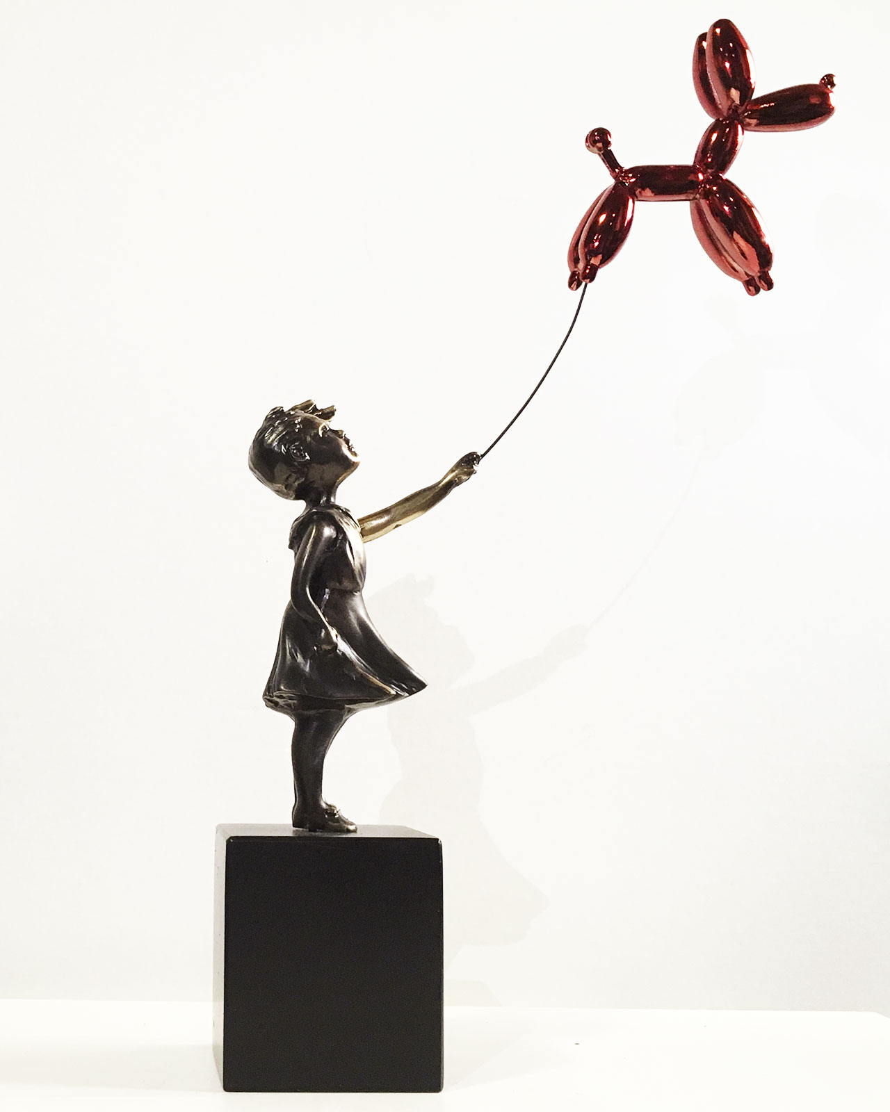 Girl with balloon dog